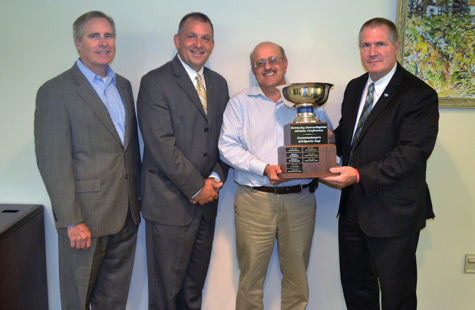 Photo courtesy of Kevin Taylor, Point Park Athletics.Point Park University administrators were presented the KIAC Commissioner's Cup by conference commissioner Scott McClure (far right). Pictured (L to R) are President, Dr. Paul Hennigan, Vice President of Student Affairs and Dean of Students, Keith Paylo, and Director of Athletics, Dan Swalga.