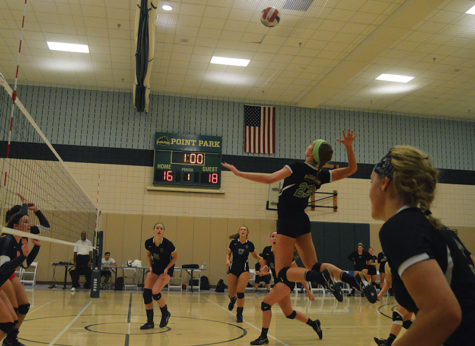 Photo by Kendall Paige. Sophomore middle/right side hitter, Ashley Taylor, makes a play during their game against Corncordia on August 24.