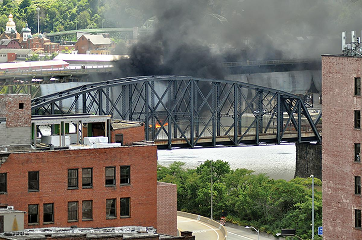 Sparks from renoviation work on the Liberty Bridge ignited a tarp covering a section of the bridge and started a fire that it to close. The bridge was fully closed on a work day for the first time in its 88-year history.