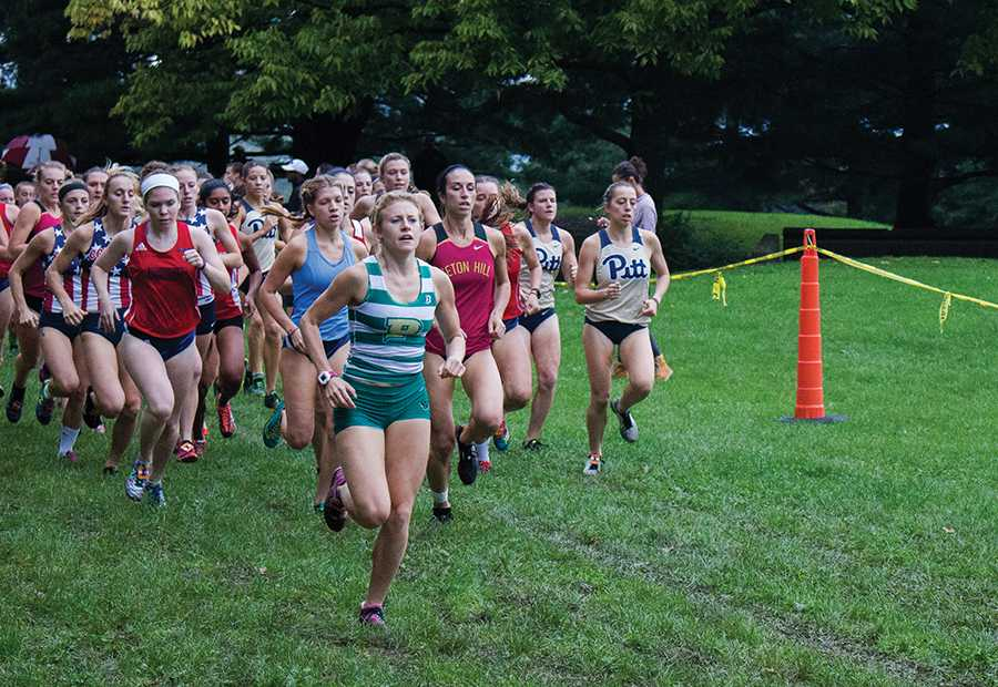 Junior+Katie+Guarnaccia+leads+the+pack+at+the+start+of+the+CMU+Invitational+on+October+8+at+Schenley+Park.