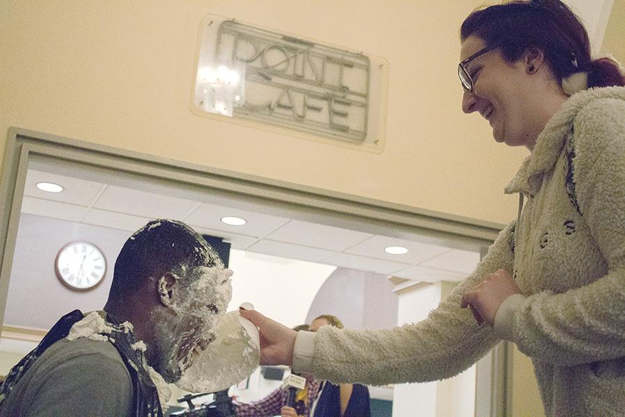"""Anntonietta Borzacchiello, journalism major, throws a pie at USG President Blaine King at """"Pie the President"""" as part of WPPJ's Rockathon on Nov. 1. All benefits went to the Early Learning Institute."""