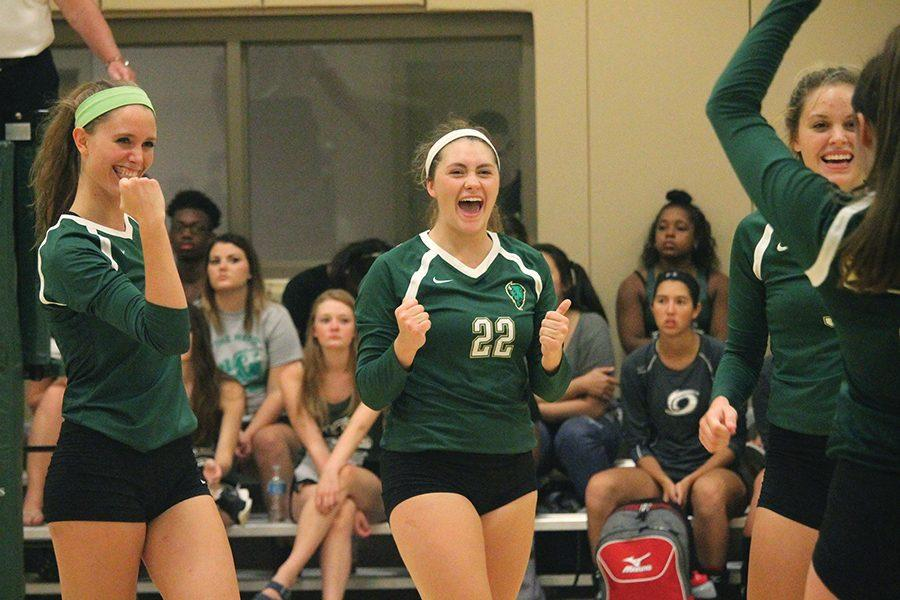 Sophomore+middle+hitter%2C+Ashley+Taylor%2C+and+freshman+setter%2C+Julia+Menosky%2C+celebrate+with+the+team+after+scoring+against+Sienna+Heights+Sept.+2.+Point+Park%E2%80%99s+volleyball+team+recently+secured+an+automatic+bid+to+the+NAIA+National+Tournament.+For+coverage%2C+turn+to+page+8.