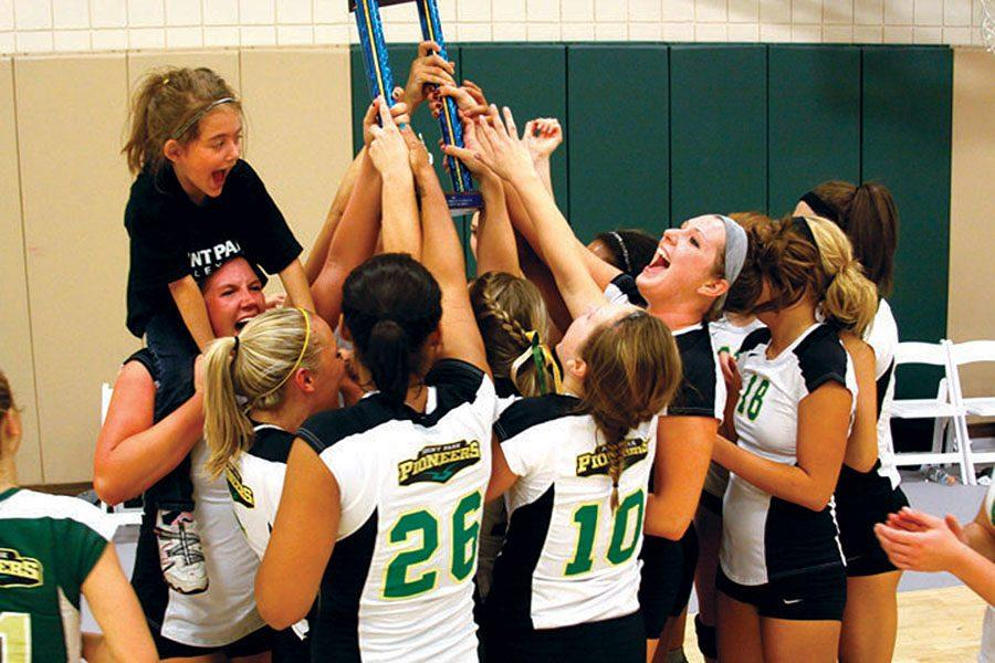 Point+Park+volleyball+celebrates+with+their+trophy+after+the+AMC+Title+Game+in+November+2011.+The+Pioneers+defeated+Daemen+3-1+to+advance+to+their+first+NAIA+National+Tournament+in+program+history.%0A