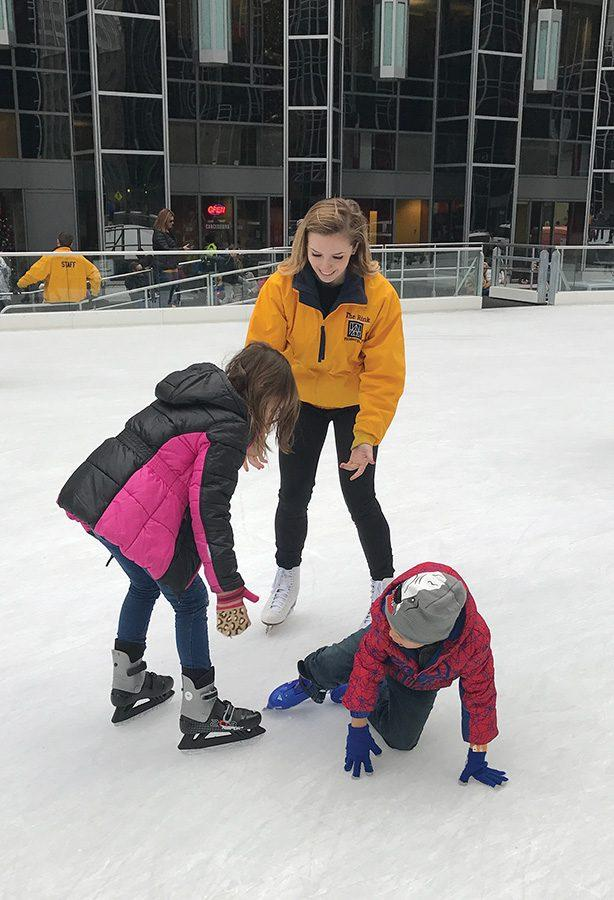 Julianna+Rink%2C+a+sophomore+dance+major+concentrating+in+jazz%2C+helps+skaters+to+their+feet+after+a+fall+at+the+MassMutual+Pittsburgh+Ice+Rink+at+PPG+Place+PPG+Rink%2C+where+she+is+a+skate+guard.