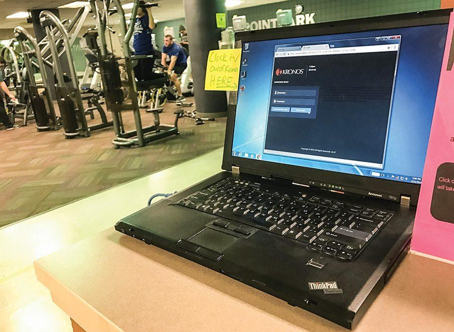 A laptop dedicated to the Kronos clock-in and clock-out system to track student work hours sits in the Student Center fitness center. Some student workers have had issues with the new software.