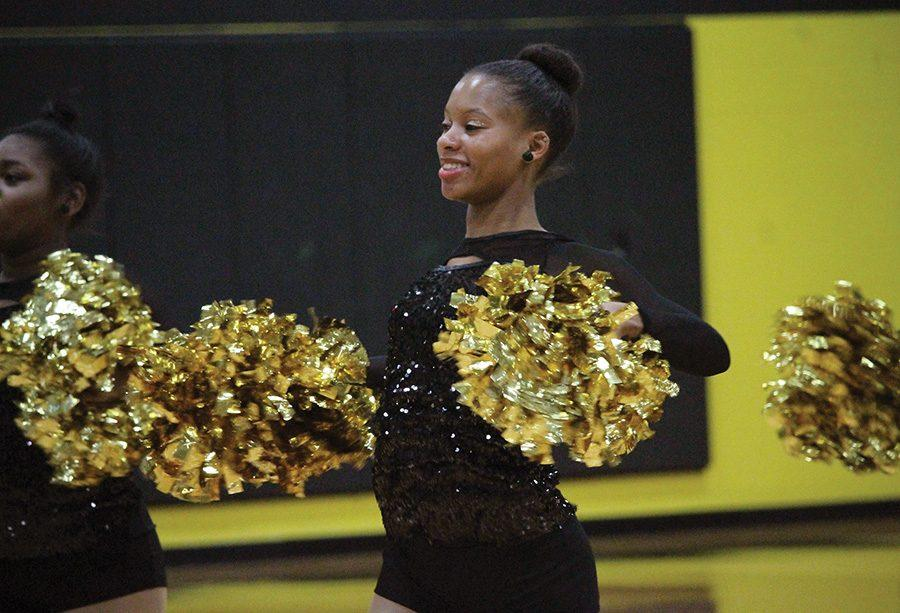 Junior+dance+team+captain+Amber+Mole+cheers+at+a+Dec.+12+basketball+game+at+CCAC+South.+