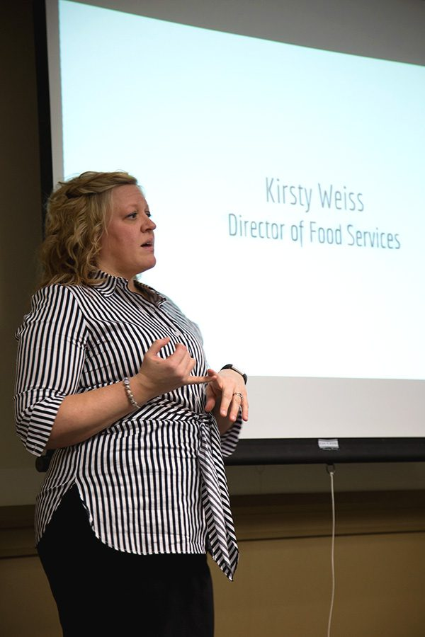 Kristy Weiss, director of dining services, discusses student complaints and recent food service changes during the current transition period at CulinArt, at a USG meeting Monday.