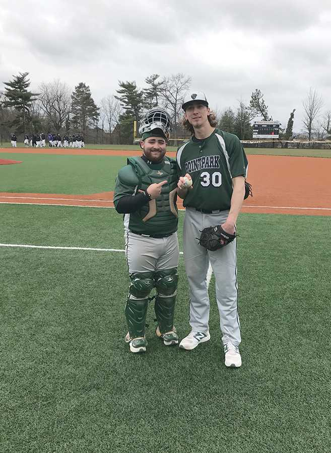 Senior pitcher Nolan Krivijanski stands with his catcher, junior Chris Hernandez, after tossing a 1-0 perfect game Saturday. The Pioneers swept the four-game series at Cincinnati Christian.