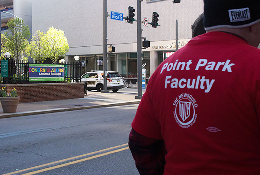 Full time faculty members demonstrated outside Lawrence Hall on admitted students day Saturday.