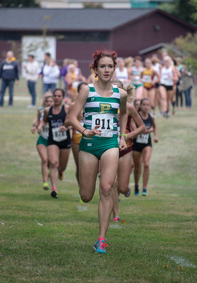 Junior+Anna+Shields+runs+ahead+of+the+pack+at+Saturday%E2%80%99s+Walsh+Invitational+in+North+Canton%2C+Ohio.+Shields+won+the+women%E2%80%99s+5K+race+and+broke+her+shared+school+record+with+a+time+of+17+minutes%2C+19+seconds.+