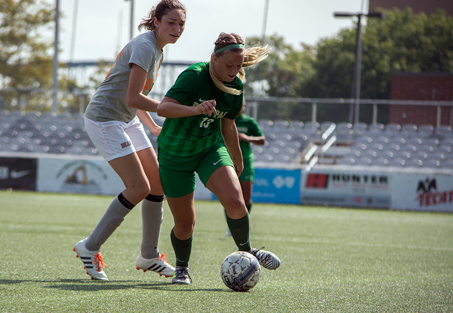 Freshman+midfield%2Fforward+Bailey+Boyd+keeps+possession+of+the+ball+away+from+an+opposing+player+at+the+Saturday%2C+Sept.+16+home+game.+The+Pioneers+beat+University+of+Pikeville+5-0+at+Highmark+Stadium.