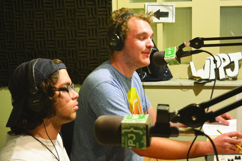 "Chris Copen and Krist Muñoz-Malavé, freshmen cinema majors, recording their show ""Radio Somewhere."""