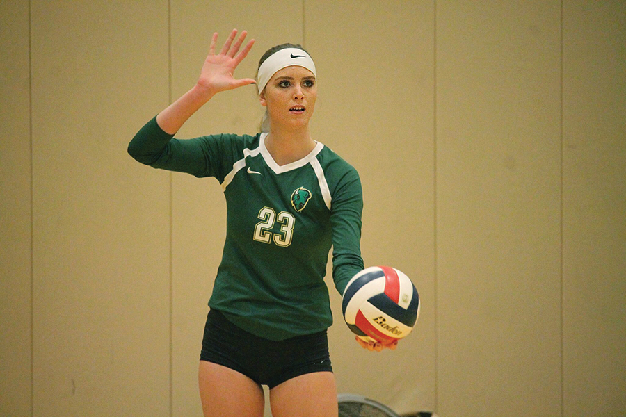 Junior right side hitter Ashley Taylor prepares to serve against IU East last Friday in the Student Center Gym. The Pioneers lost the heart breaker 2-3.