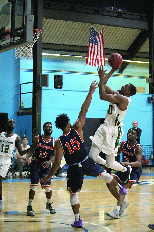 Senior forward Fousseini Konate shoots for a layup against Washington Adventist in Point Park's home opener Nov. 22. Konate scored the team-high of 22 points for the Pioneers.
