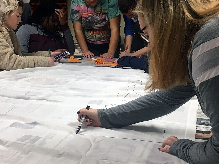 Students met on Nov. 2 to make signs for the silent protest and write on post-its why they are against Ruddy speaking.