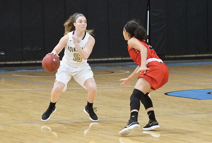 Freshman+guard+Michelle+Burns+takes+on+a+Rio+Grande+defender+on+Nov.+29+at+CCAC+Allegheny.+She+entered+the+week+leading+the+Pioneers+in+scoring+with+12+points+per+game.+