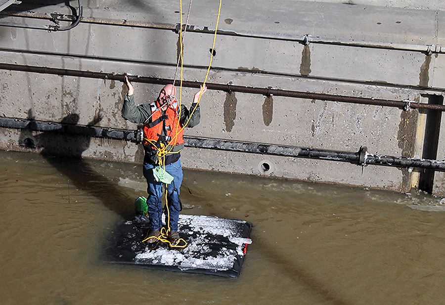 Rescue personnel throw down ropes to Corbin to keep him above water until Pittsburgh River Rescue can make it to him.