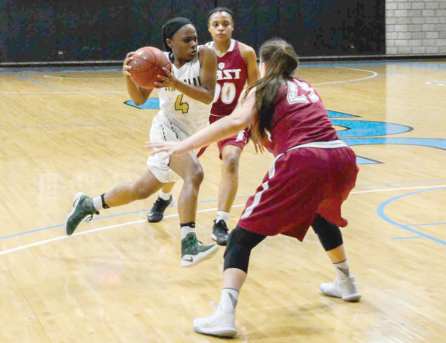 Senior guard Shaniya Rivers drives through IU East defenders in a 96-78 loss last Tuesday at CCAC Allegheny