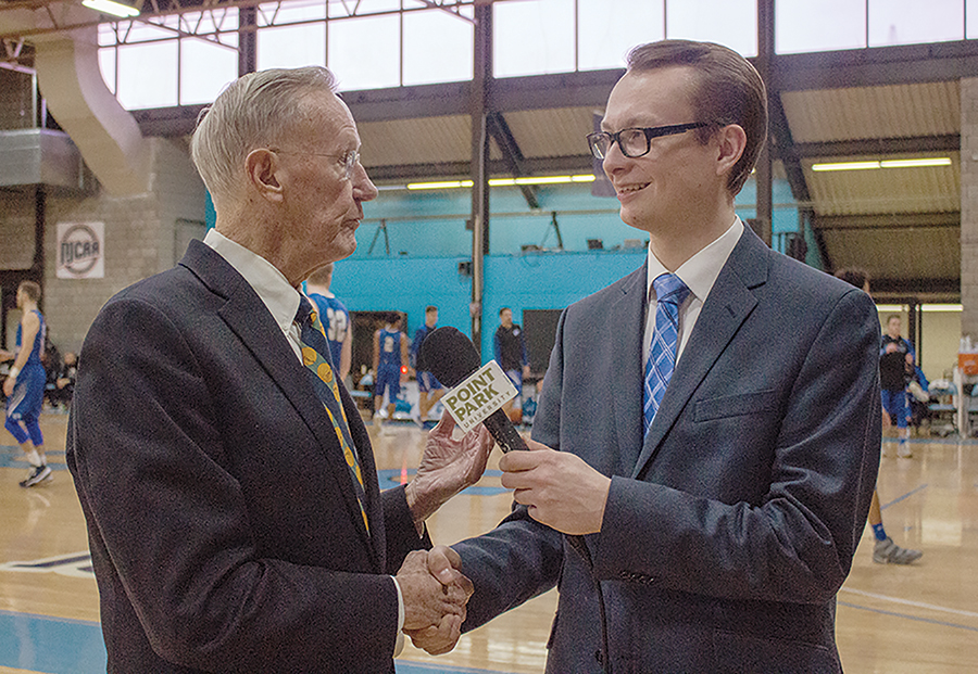 Jerry Conboy (Left) interviews with The Globe's co-sports editor, Josh Croup (Right) at the men's basektball program's 50th anniversary celebration Saturday at CCAC Allegheny. Conboy coached the Pioneers for 20 years from 1969-89 and was inducted to the Pennsylvania Sports Hall of Fame last year.