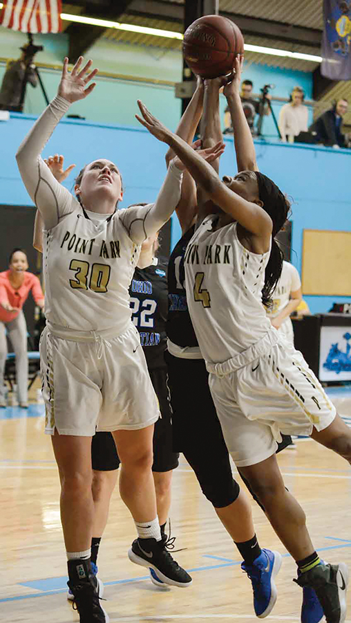 Junior forward Sam Weir and senior guard Shaniya Rivers fight for a rebound against Ohio Christian Saturday.