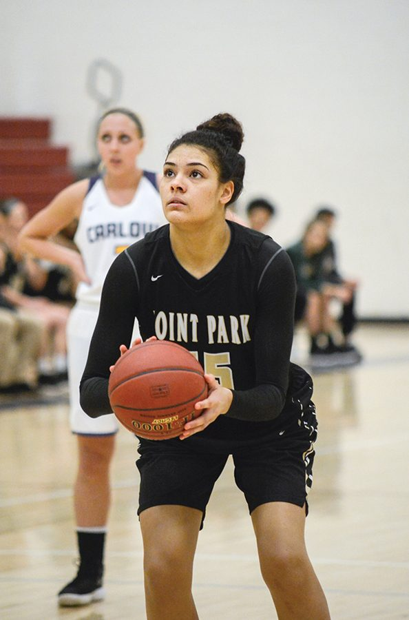 Senior+forward+Baylee+Buleca+shoots+a+layup+last+week+at+Carlow.+She+is+second+on+the+team+with+7.2+rebounds+per+game+entering+the+playoffs.