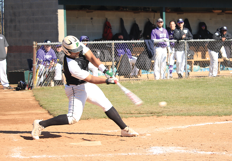 Junior infielder Billy Kidd drives one of his three hits during the team's home opener against conference opponent Cincinnati Christian. Through 22 games, Kidd is batting .345 and has regularly started at second base.