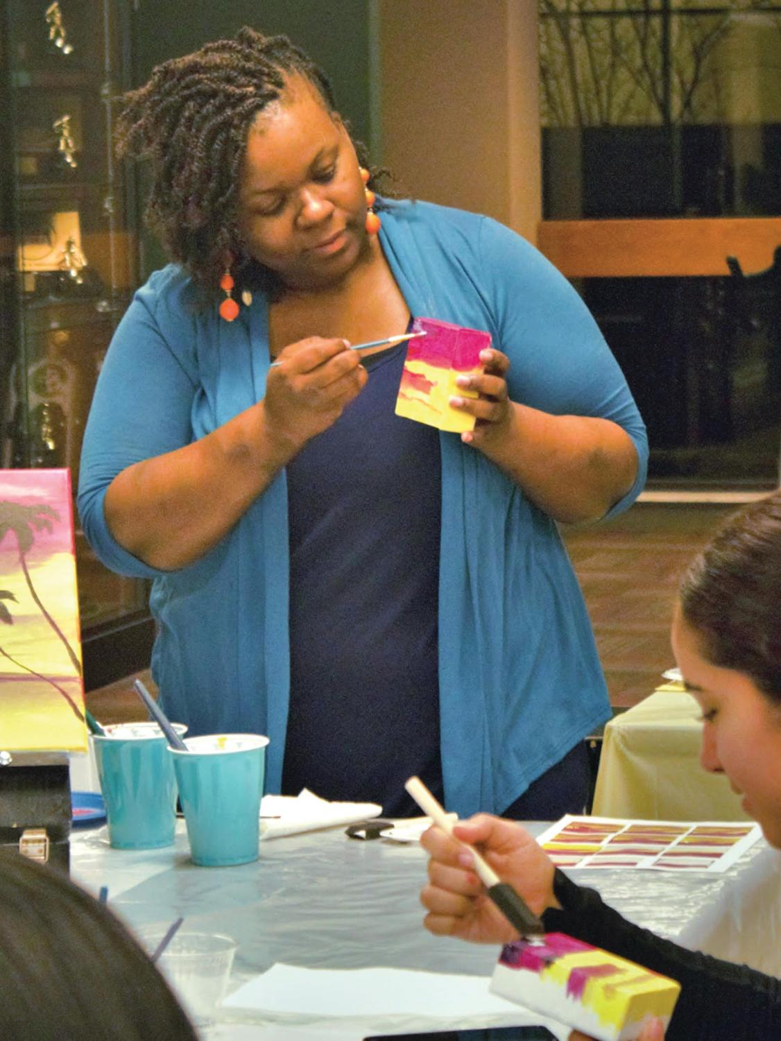 BSU members participate in art therapy during the pop-up paradise event.