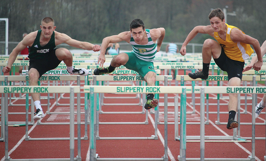 Junior Bryan Partika (Middle) hurdles at an outdoor meet last season. Partika placed second in the 400 mete hurdles with a time of 58.04 seconds this past weekend at the Bethany Invitational.