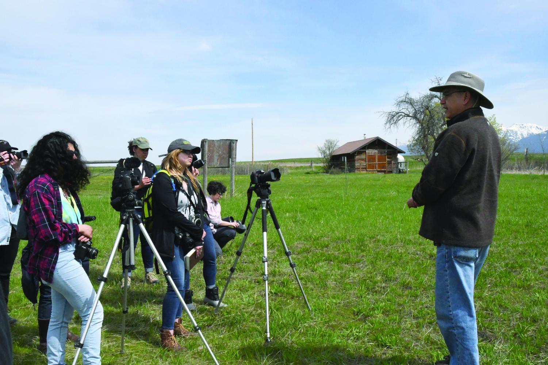Students of the environmental photography class interview Kootani Councilman David Stiffarm.