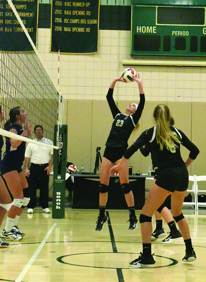 Senior Ashley Taylor sets the ball during a 2017 contest in the Student Center Gym. The Volleyball team holds a 1-3 record and will compete in the Emileigh Cooper Memorial Tournament this weekend in Rio Grande, Oh.