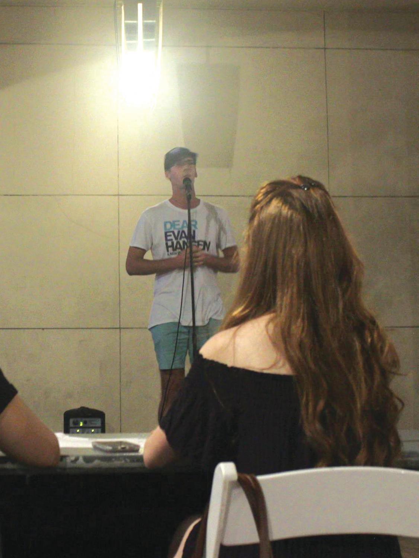 Junior SAEM major Krystopher Baklarz sings at an audition in Village Park on Thursday.