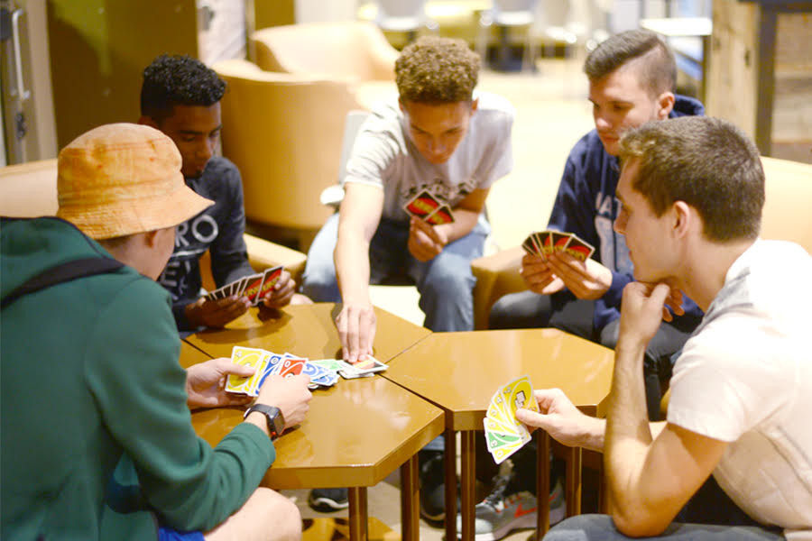 The executive board of the Point Park Uno League plays a game of Uno in campus coffee shop Point Perk.