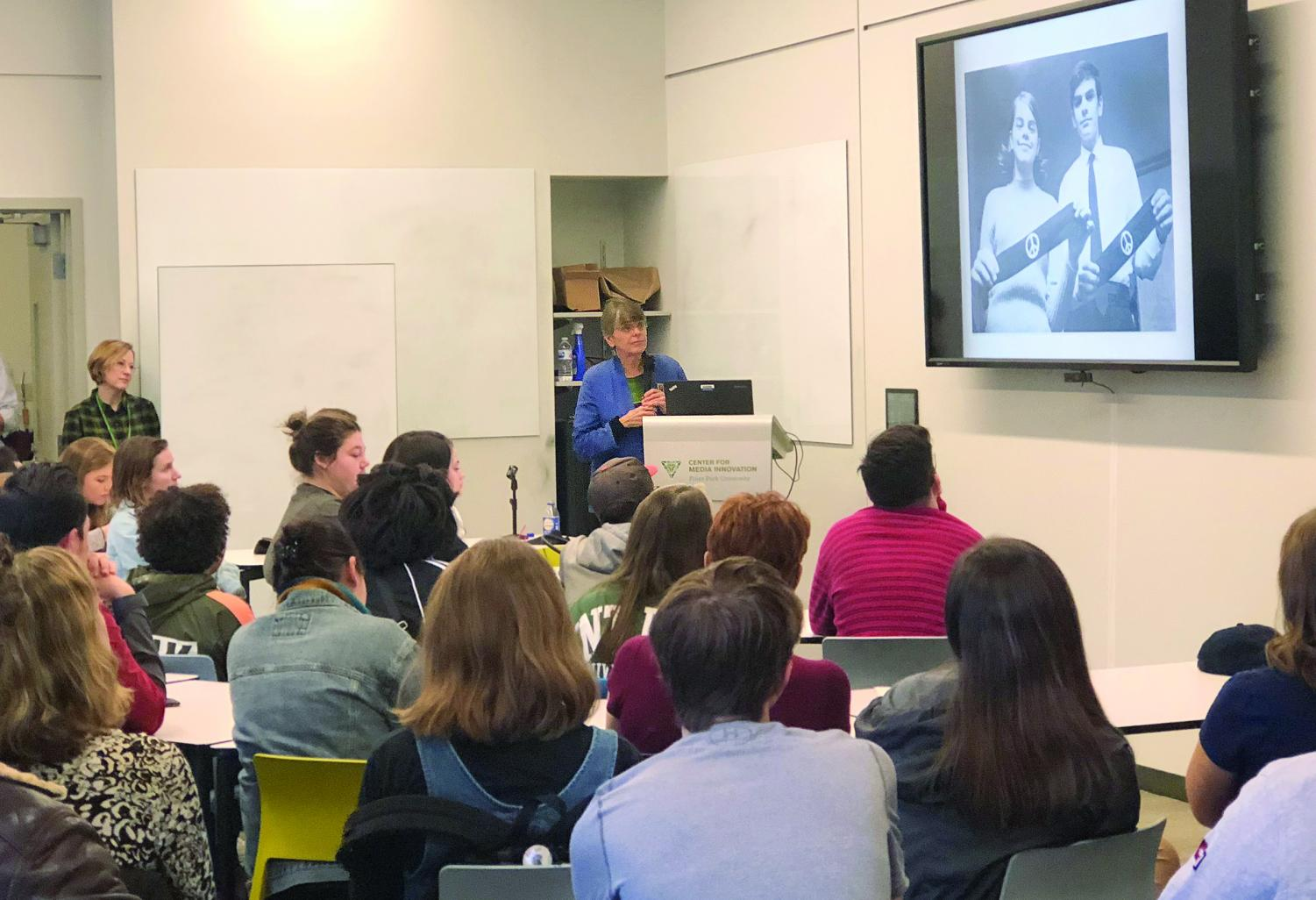 Mary Beth Tinker presents a photo of herself with her iconic armband to students at the CMI.