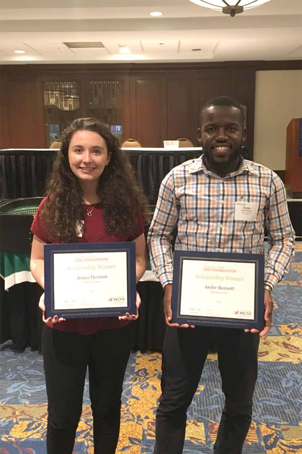 Scholarship winners Jenna Herman and Andre Bennett pose with their awards at the PICPA Casino Night on Sept. 24.