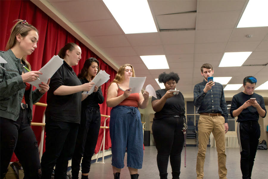 Members of On Point A Cappella rehearse together on Sunday, Oct. 28 on the fifth floor of Lawrence Hall.