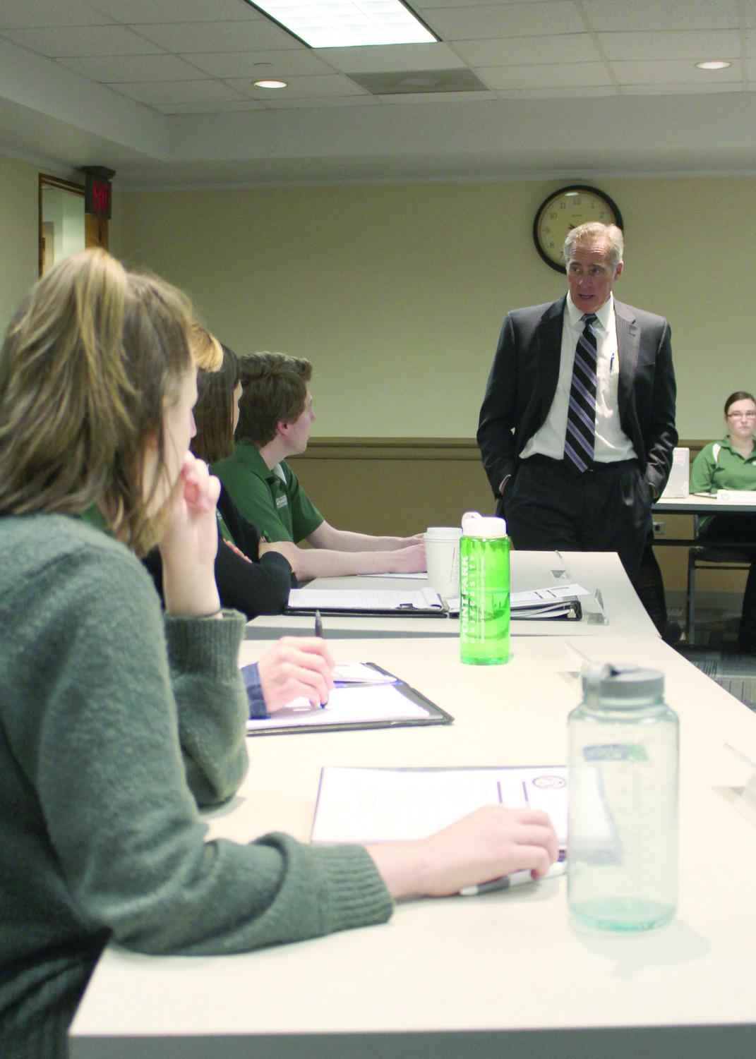 President Hennigan addressed USG and student concerns regarding tuition and housing at their meeting on Monday.