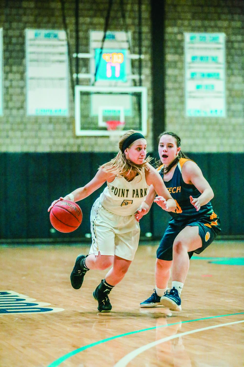 Junior guard Baylie Mook dribbles around a defender during a match-up against WVU Tech earlier this month. The women's team is now 6-11 overall on the year and 2-4 in conference play.