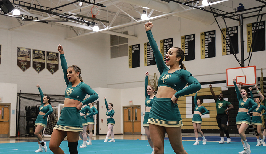 The competitive dance team competes against Aquinas at their first home meet earlier this month. Last weekend, the team ended the day with a score of 85.96 and placed first out of six teams.