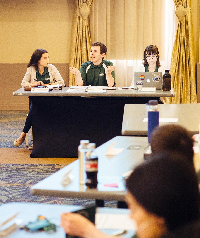 Vice President Brittany Arp, Parlimentarian Matthew Spadaccia and Recording Secretary Sophie Burkholder address USG.