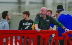 Track and field head coach terminated last Friday