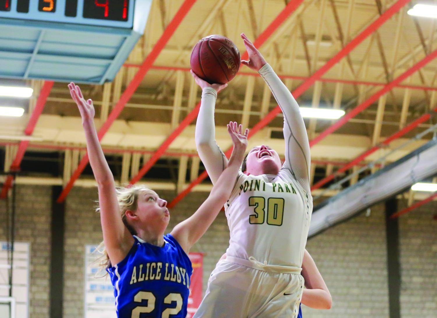 Senior guard Sam Weir attempts a layup during a game earlier this season against Alice Lloyd. Weir totaled 18 points last week against Carlow.