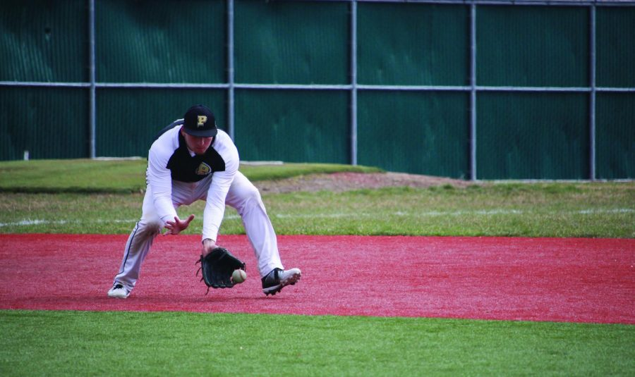 Senior third baseman Erik Montero fields a ground ball during a 2017 game. The senior is one of the few returning starters from last year's team which won the River States Conference Championship.