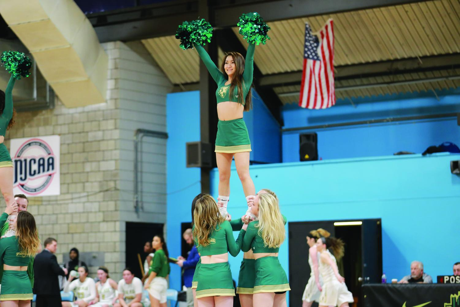 Members of the Competitive Cheer team perform during a home basketball game earlier this season at the CCAC Allegheny Campus Gym.