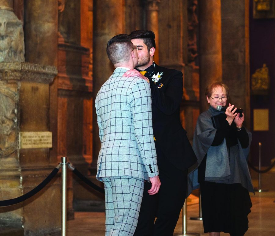 Colten Gill (left) shares a kiss with his husband, Louis Spanos (right) at their wedding on Thursday, Feb. 21. The couple, who both graduated from Point Park University, won a contest to be married at the Carnegie Museum of Art. Gill and Spanos were selected out of 73 couples who submitted their love stories to the museum in hopes of winning the free wedding.