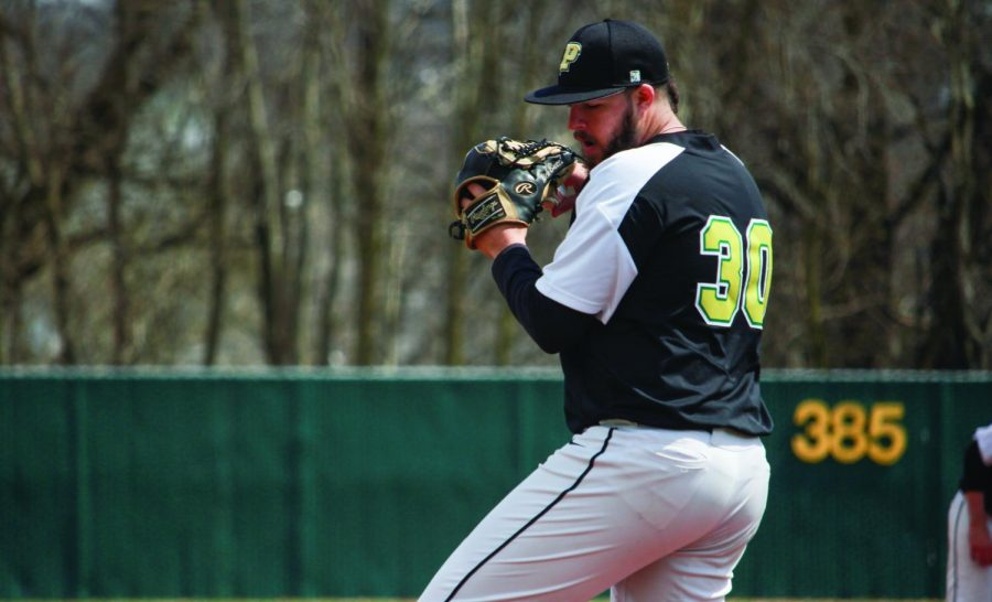 Senior+Nick+Bucci+pitches+in+a+2018+game.+Through+six+starts+this+season%2C+Bucci+leads+the+team+with+a+1.37+ERA+through+26.1+innings+pitched.+He+allowed+five+runs+through+4.2+innings+against+IU+Kokomo+last+weekend.