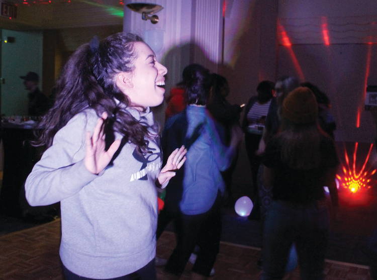 """Jacquelyn Hearn, a  sophomore dance major, dances to the music during SAEM club's """"End of the Year Bash"""". The music at the event was provided by a DJ from the now-closed Cruze bar."""