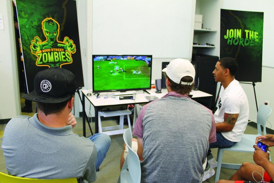 Students+play+Super+Mario+Strikers+at+the+tournament+hosted+by+the+Rowland+School+of+Business+Friday%2C+April+12.+