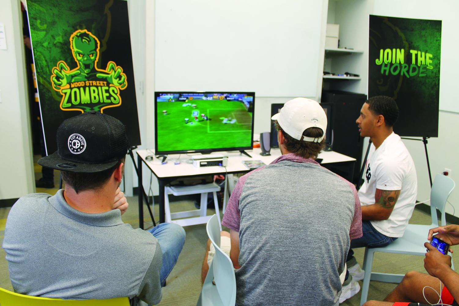 Students play Super Mario Strikers at the tournament hosted by the Rowland School of Business Friday, April 12.