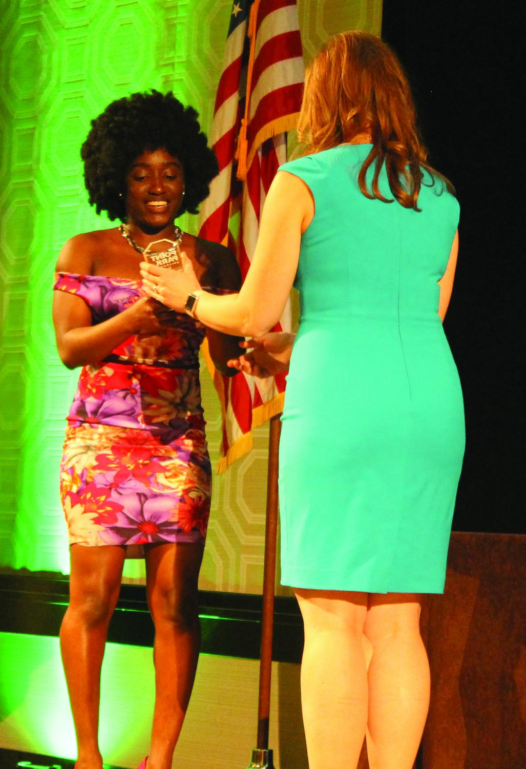 Monae Findley accepts the Outstanding Program of the Year award for the Pop-Up shops put on by the Point Closet.