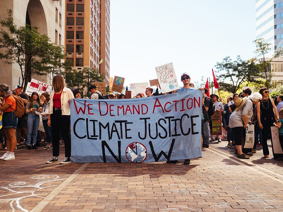 The+Climate+Strike+marches+down+Grant+St.+in+downtown+Pittsburgh+on+Sept.+20.+People+of+all+ages+participated+in+the+Pittsburgh+Climate+Strike+on+Sept.+20+organized+by+The+Action+Network.+Marchers+were+encouraged+to+wear+red+and+black+as+well+as+bring+signs.+